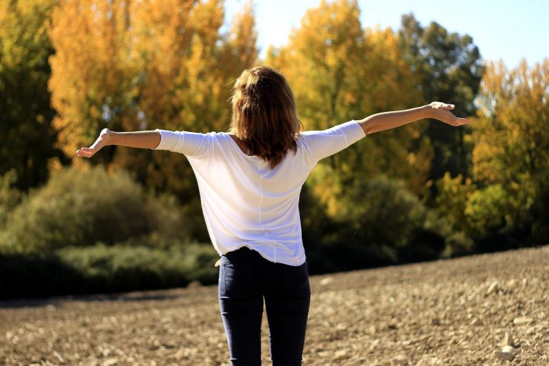 positive woman with arms wide